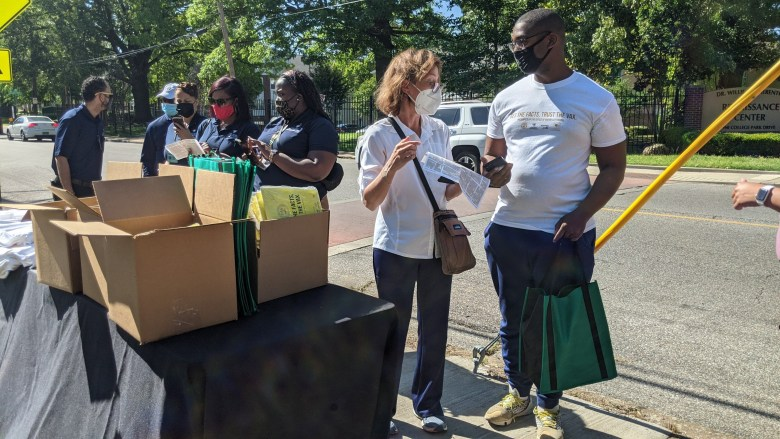 Volunteers collect materials before heading out to a vaccination event in South Memphis.