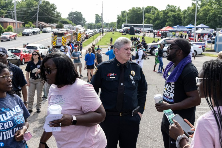 James Ryall with the Memphis Police Department talks to community members during a rally against gun violence.