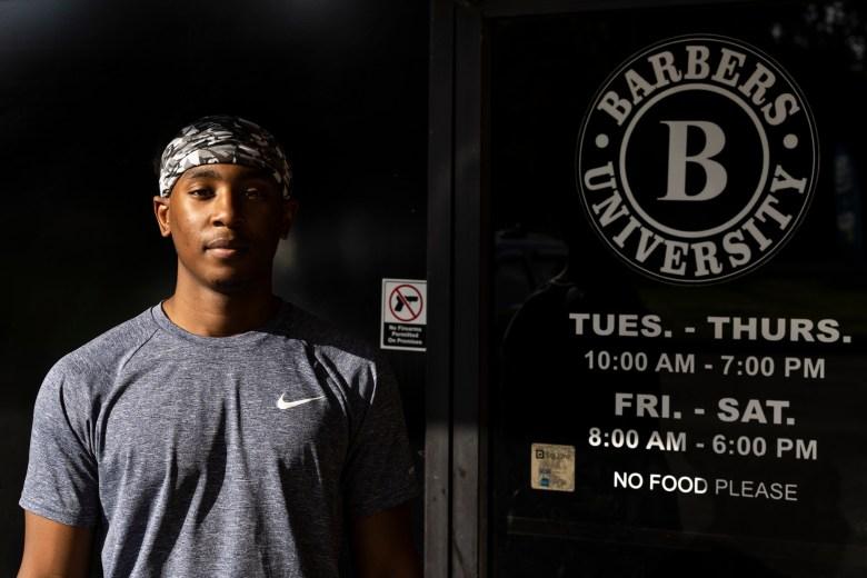 Student Jerry Johnson stands by the door of Barbers University School.