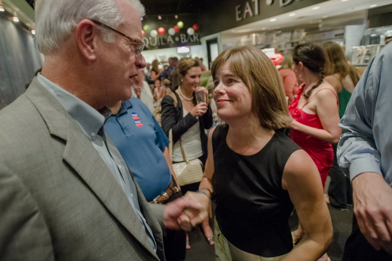 Shelby County DA Amy Weirich shakes hands with Shelby County Mayor Mark Luttrell in 2012.