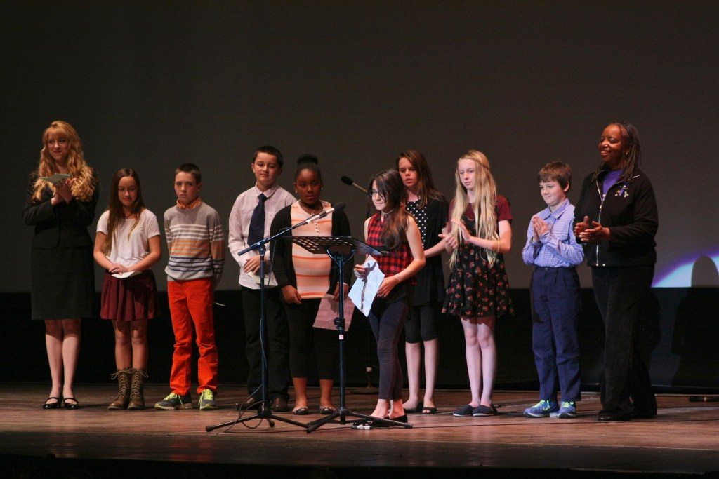 "19 January 2015-Santa Barbara, CA: The Arlington Theater Program; Essay/Poetry Winners-Ages 6-12 with Sojourner Kincaid Rolle and Amanda Kramer.   Essay - Ages 6-12 1st    Jaiani Hammonds      Franklin  2nd  Allison Mooney        Roosevelt 3rd   Maddie Fitz             Roosevelt  3rd   Charlie Hess            Roosevelt  Poetry - Ages 6-12 1st   Celene Sanchez        Roosevelt 2nd  Lola Crane-Flores    Roosevelt 3rd   Owen Rybnicek        Roosevelt 3rd   Jeffrey Helman         Roosevelt  Santa Barbara Honors Dr. Martin Luther King Jr. with a Day of Celebration.  The Santa Barbara MLK, Jr. Committee chose ""Drum Majors for Justice"" as it's theme for the day which included a Pre-March Program in De la Guerra Plaza followed by a march up State Street to the Arlington Theater for speakers, music and poetry.  The program concluded with a Community Lunch at the First United Methodist Church in Santa Barbara.  Photo by Rod Rolle"