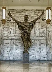 Photo of a statue of Lady Justice holding up the scales of justice.