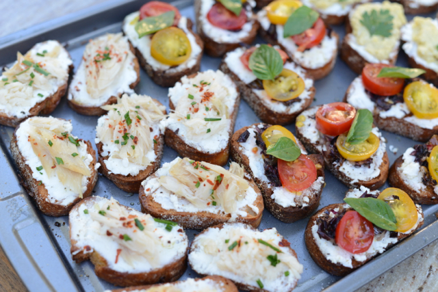smoked fish crostini, cherry tomato and basil crostini, artichoke tapenade crostini