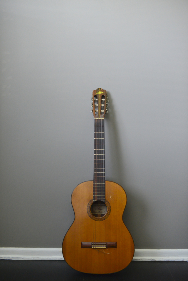 guitar in gray room, M Loves M