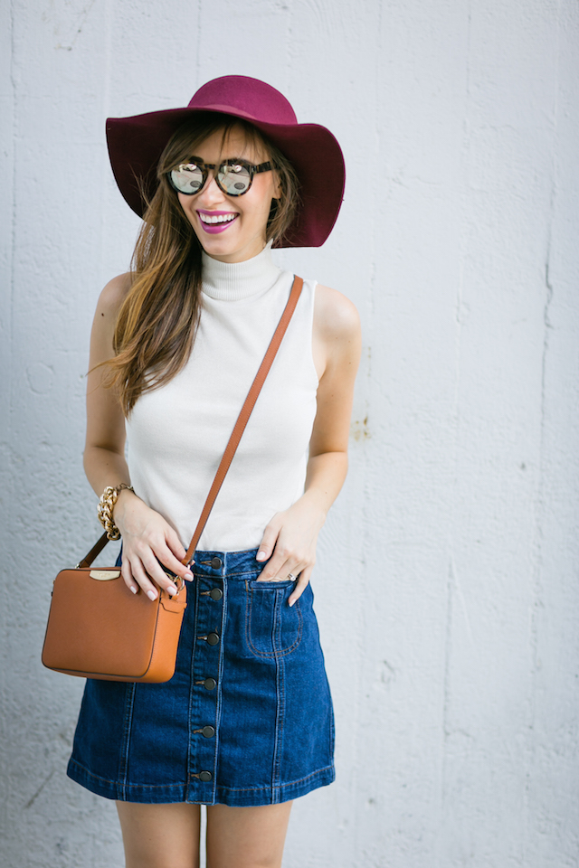 burgundy hat with white turtleneck and denim button-front skirt and crossbody bag M Loves M @marmar