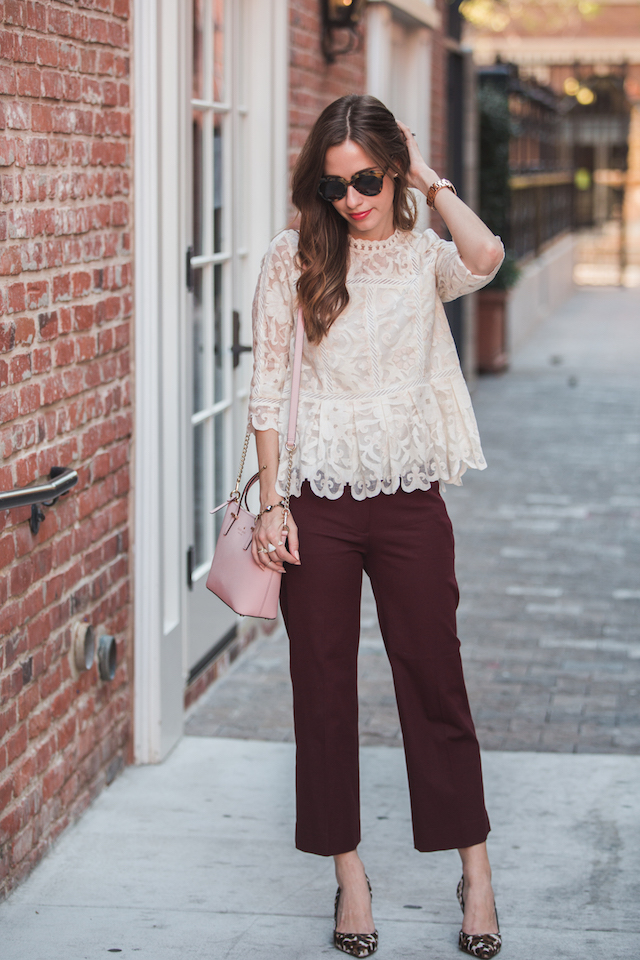 lace top and burgundy pants