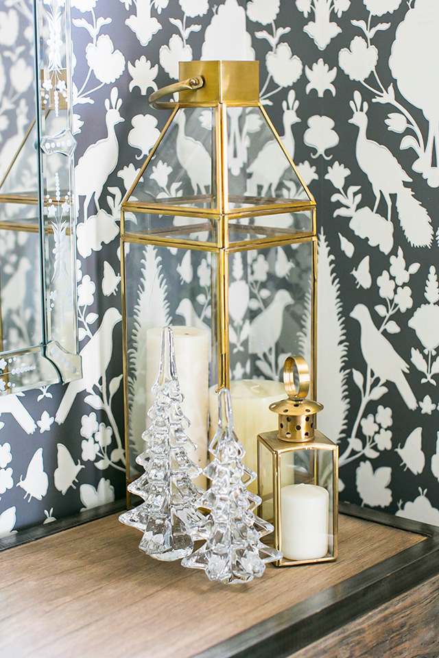 gold lanterns with candles and glass christmas trees M Loves M