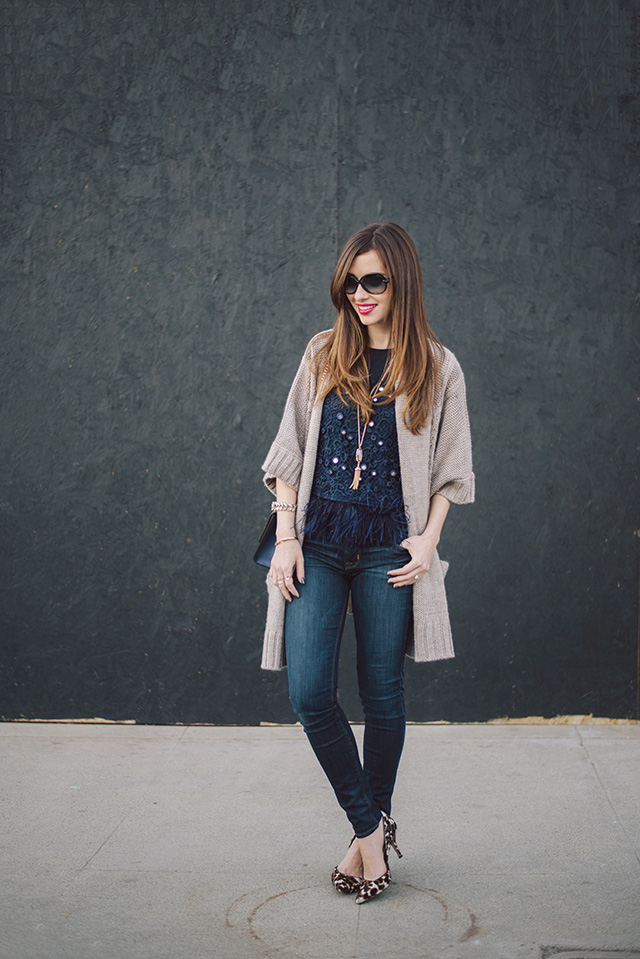 blue feather top with blue jeans M Loves M