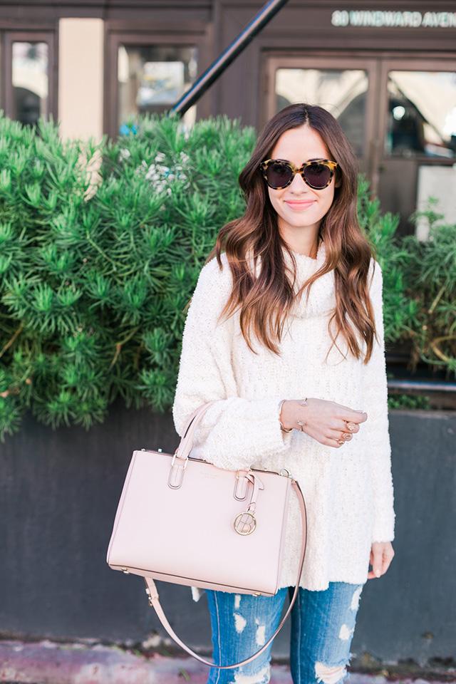 white fluffy turtleneck sweater with pink henri bendel bag M Loves M