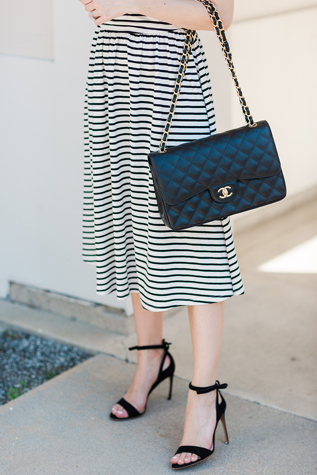 classic outfit with striped dress and black Chanel bag
