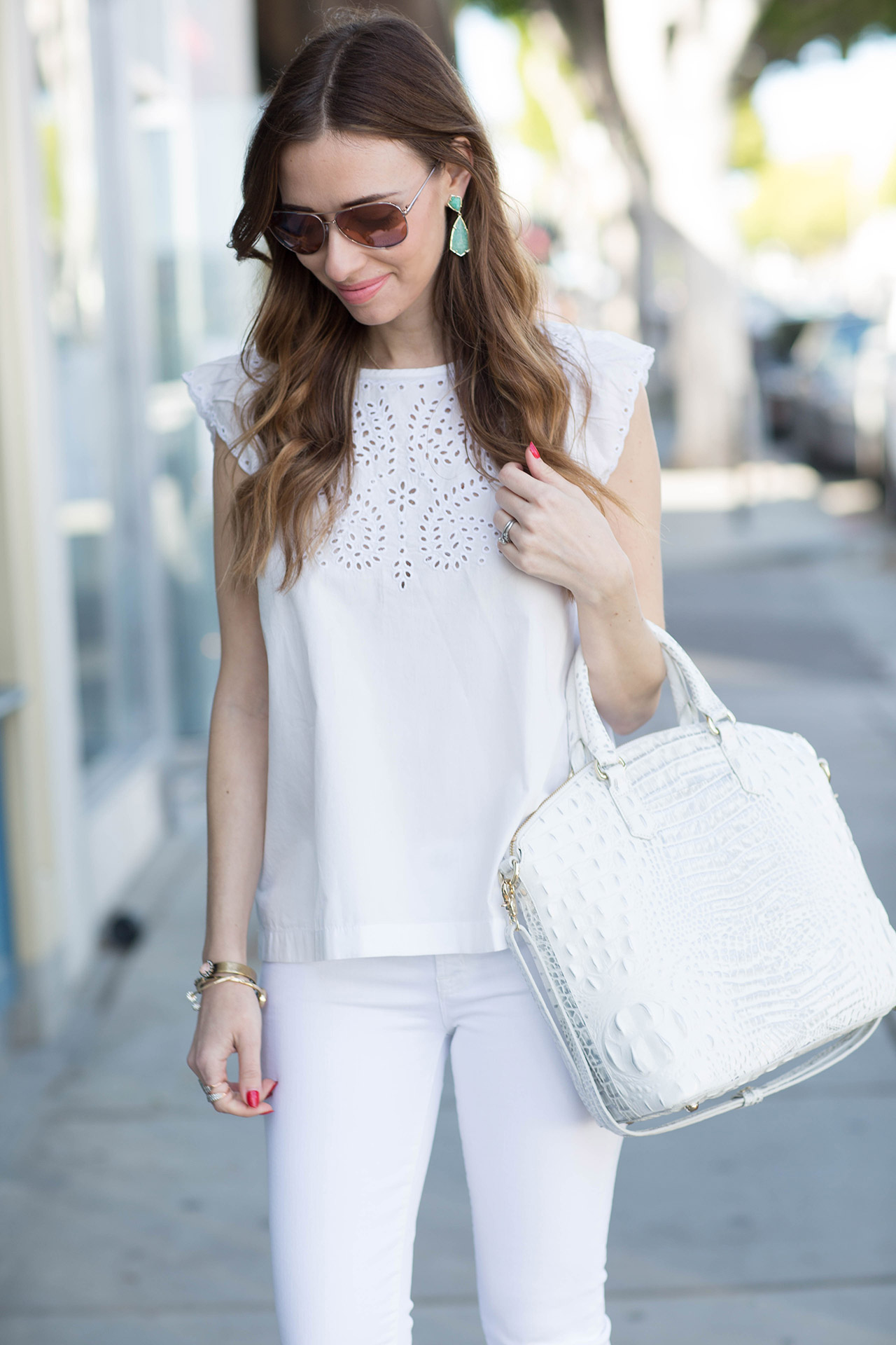 styling colorful earrings with a white outfit