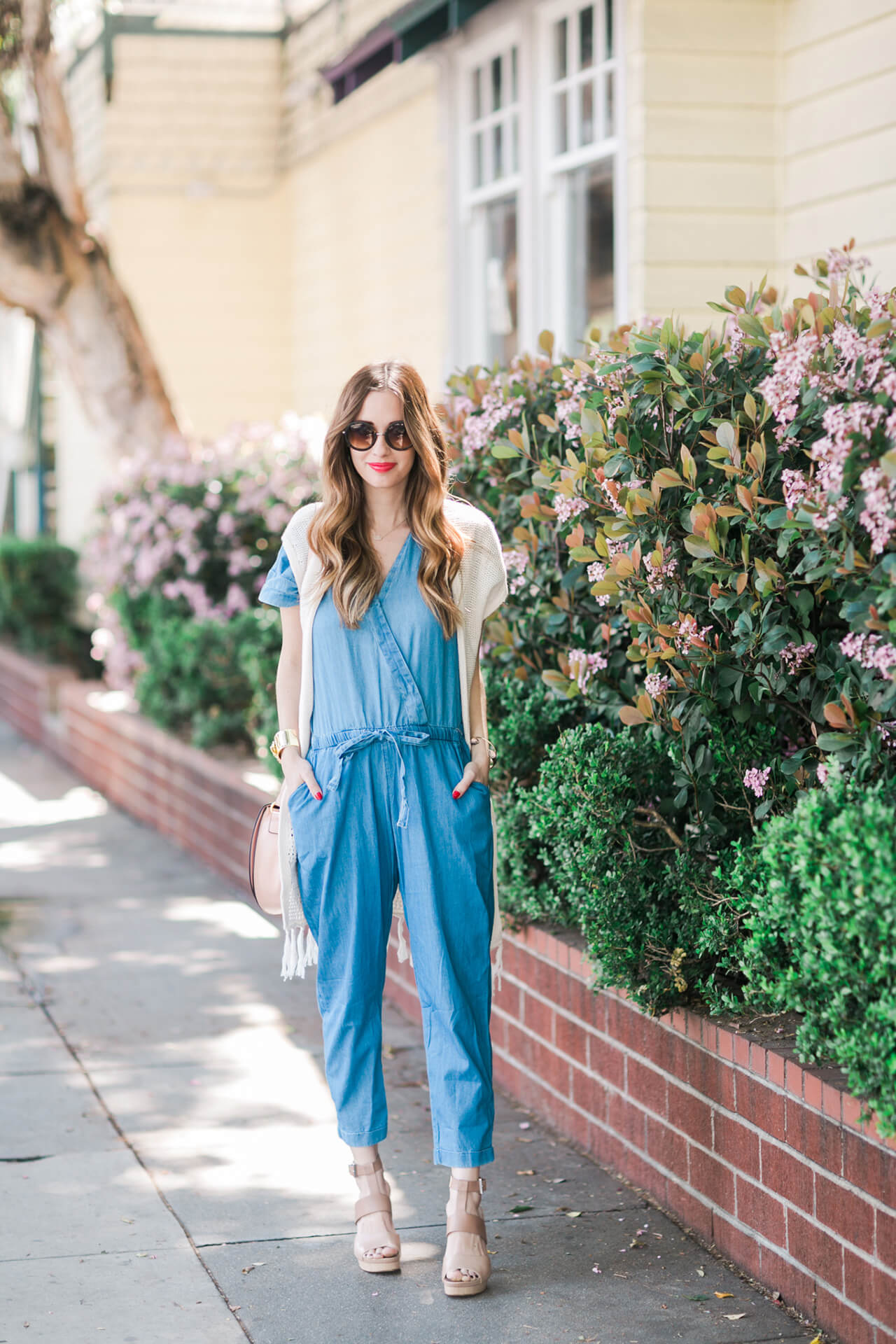 a boho-inspired festival outfit with a chambray jumpsuit and a fringe cardigan- M Loves M