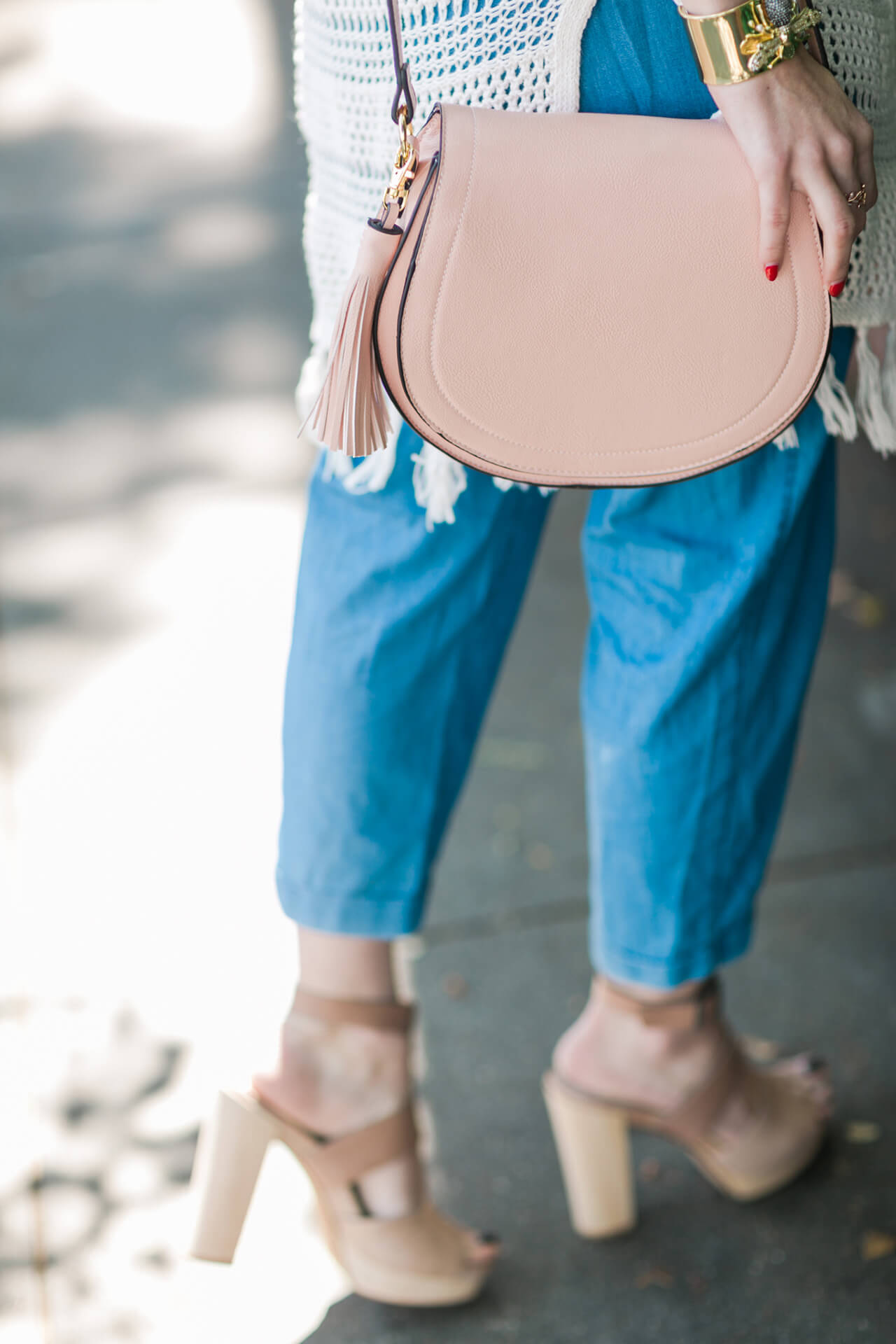 a cute pink saddle bag with tassels for under $35!