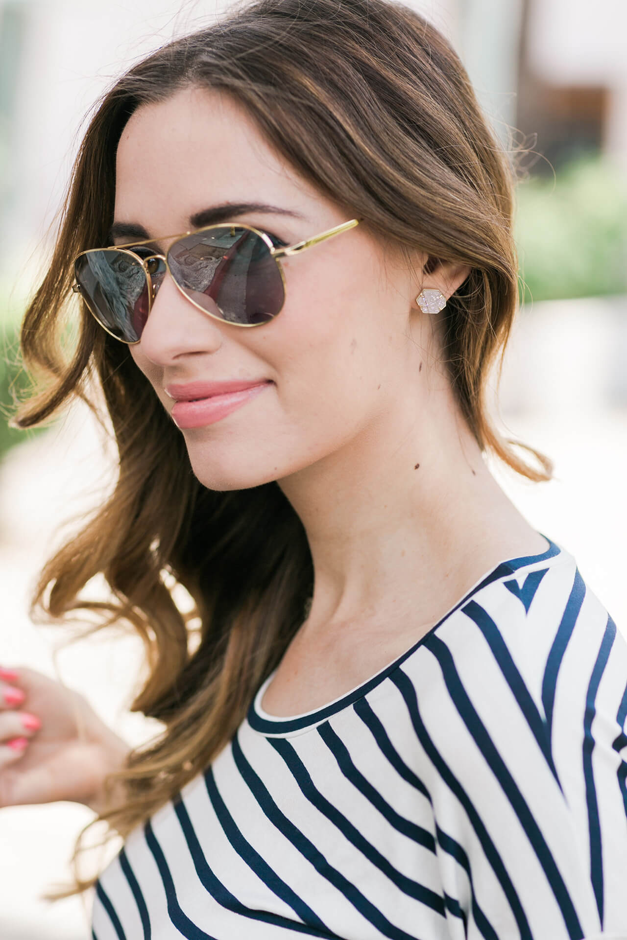 striped long sleeve top with silver aviator sunglasses
