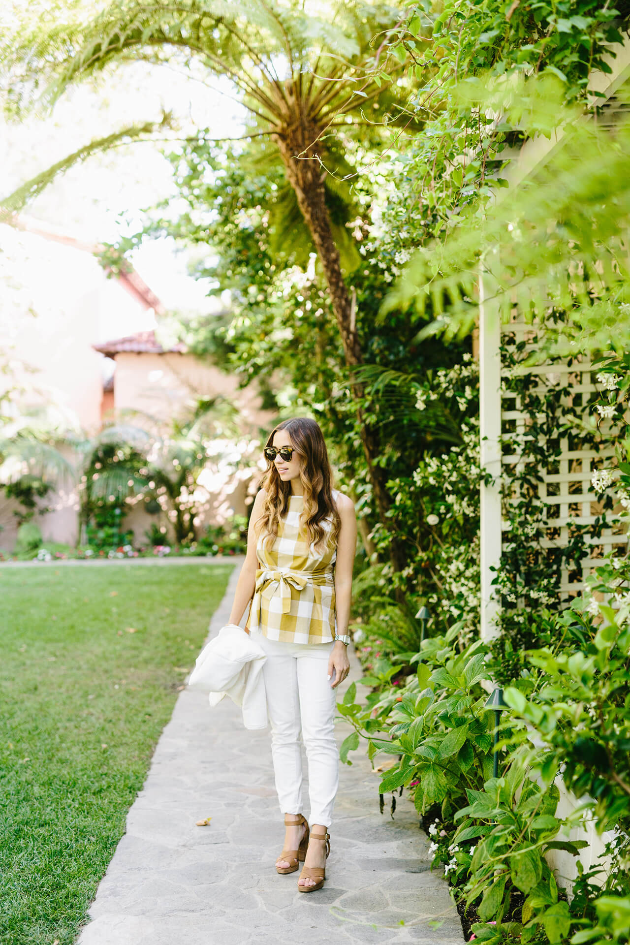 casual spring outfit with mustard gingham top and white jeans