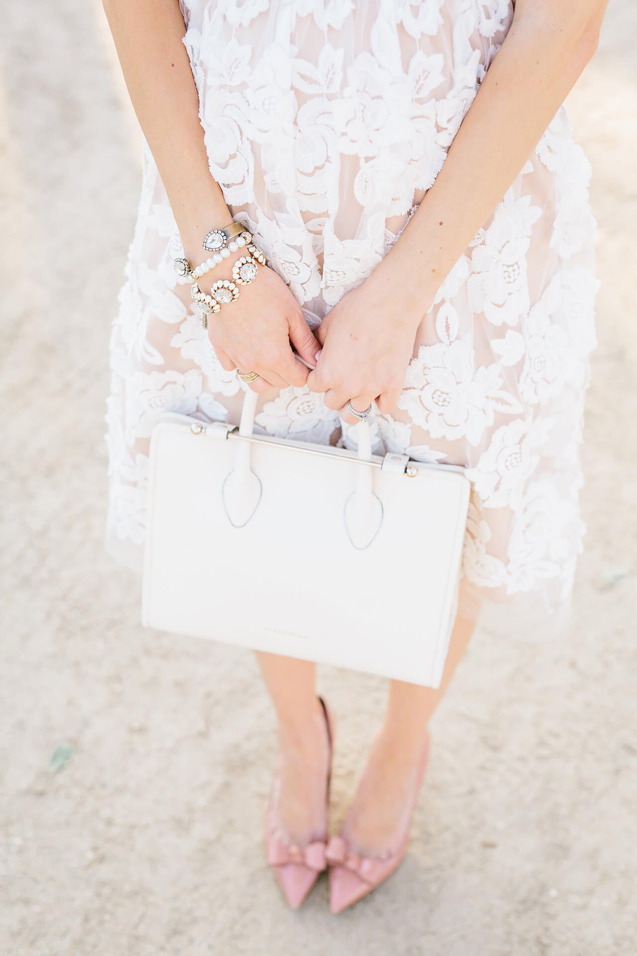 white floral dress with structured strathberry midi tote