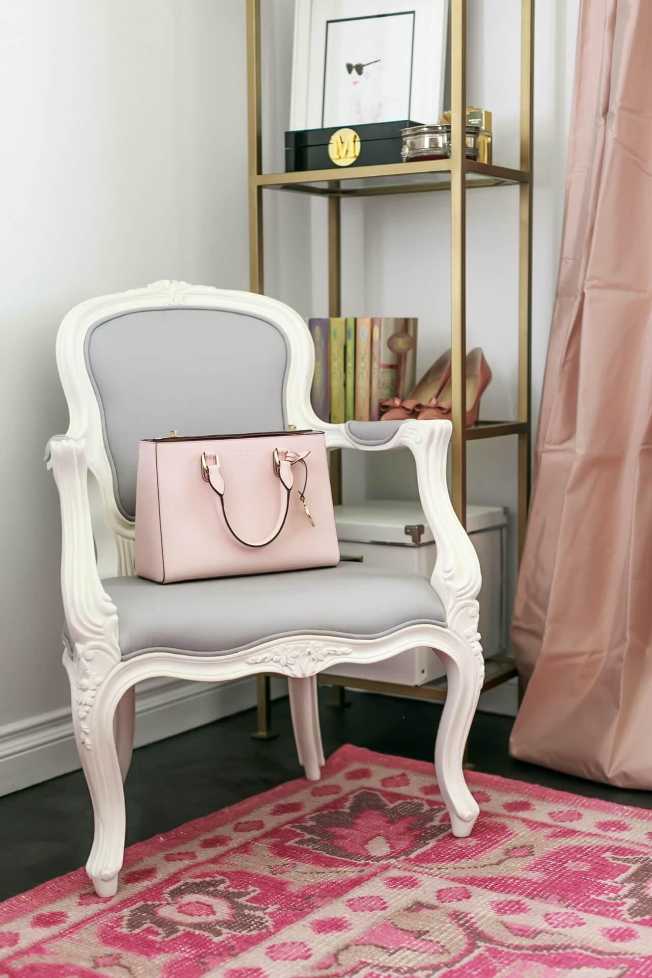 gray chair with pink purse sitting on top