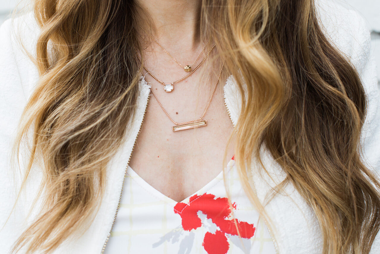 necklace layering with a floral tank