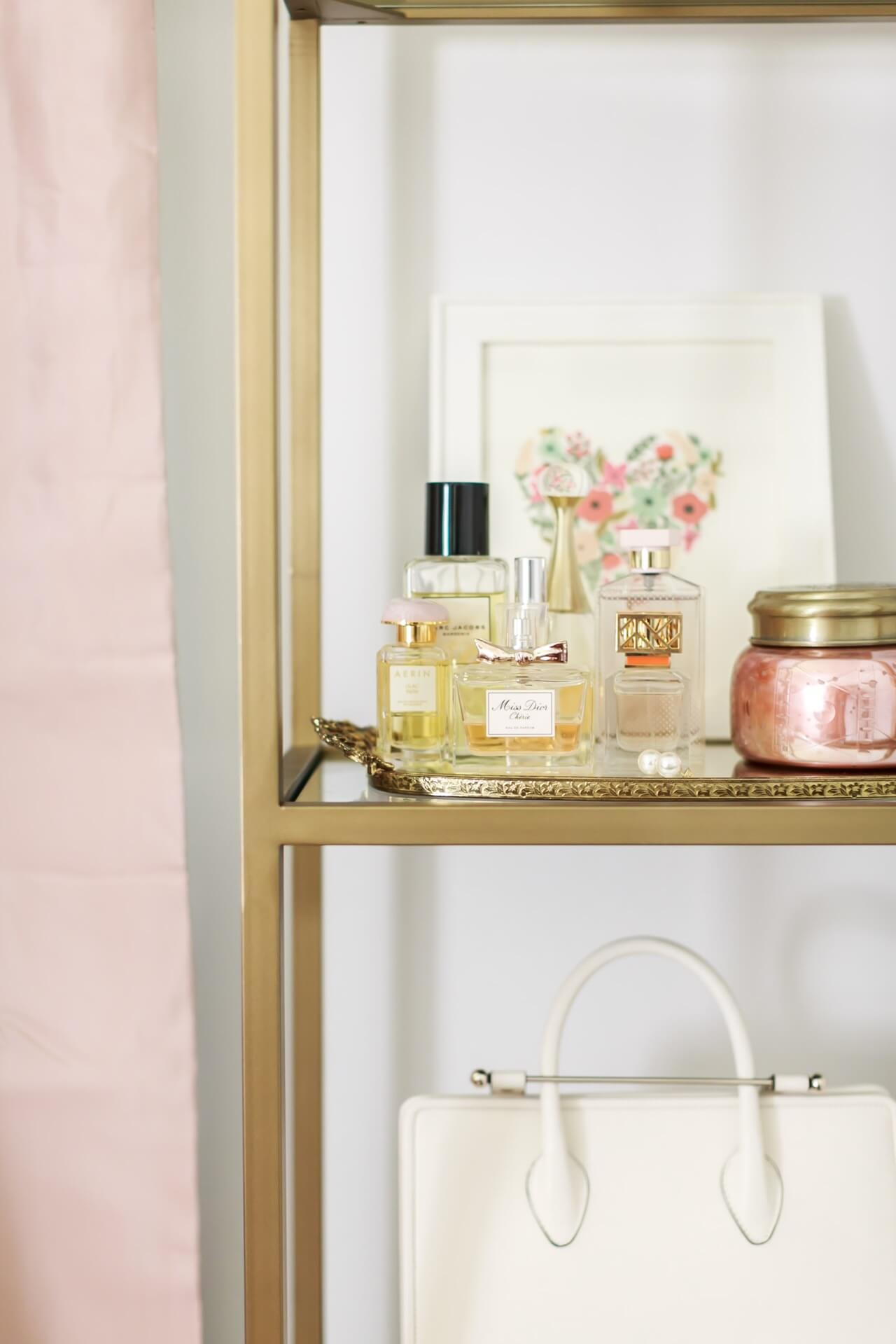 tray of perfume on bookshelf