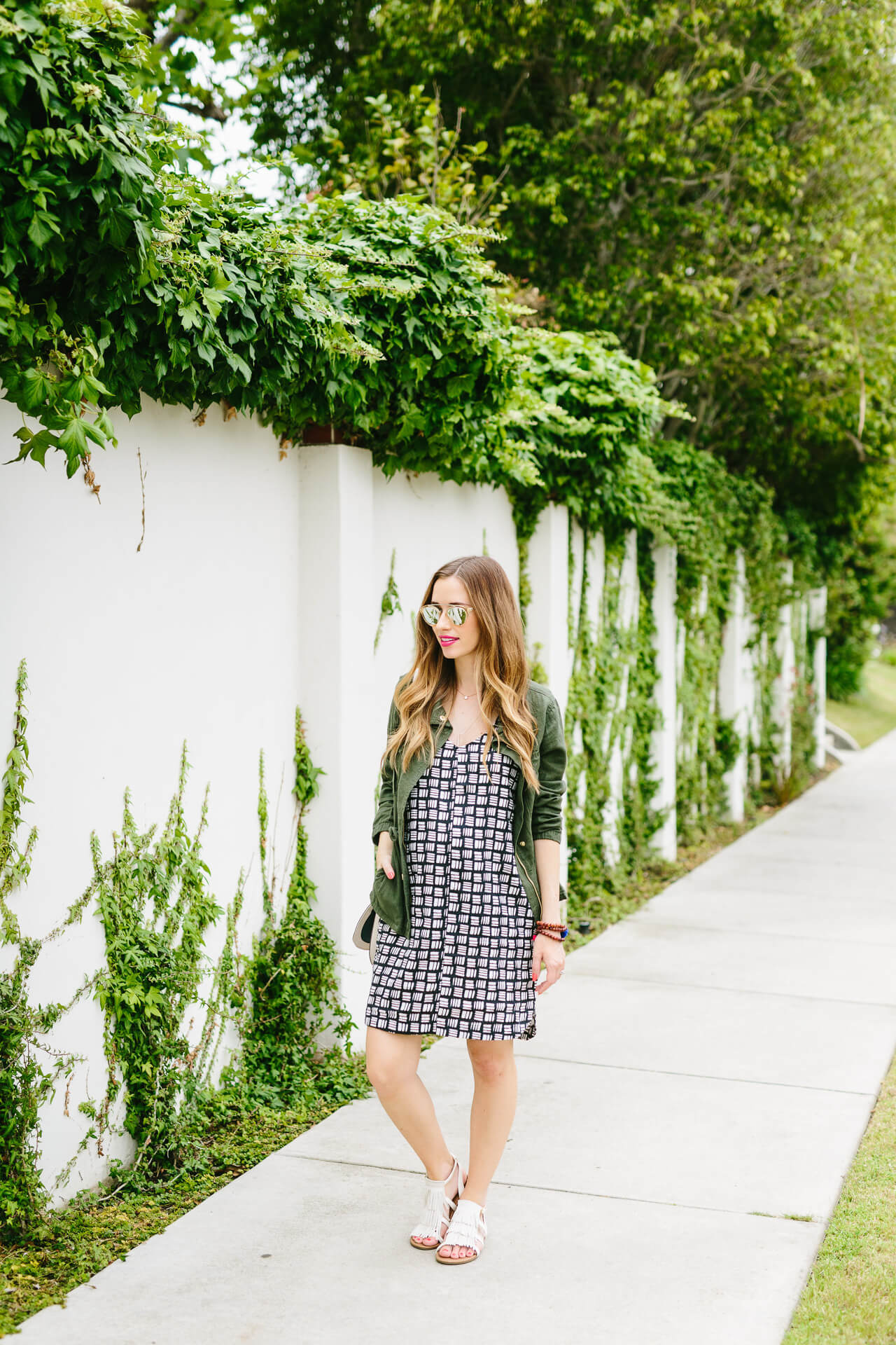 styling a bold black and white print with fringe sandals