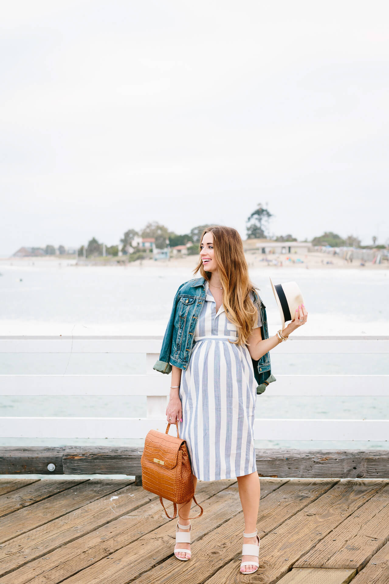 a cute casual summer outfit with a striped shirtdress and denim jacket, featuring two of my favorite elements for summer outfits