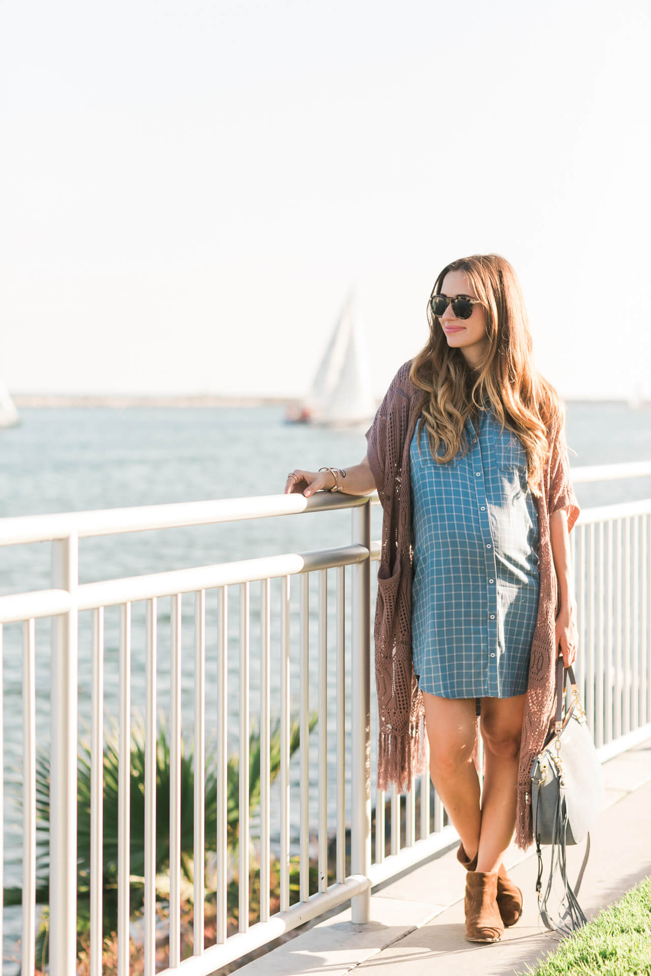 dressing the bump with a light blue checkered shirtdress and brown ankle booties