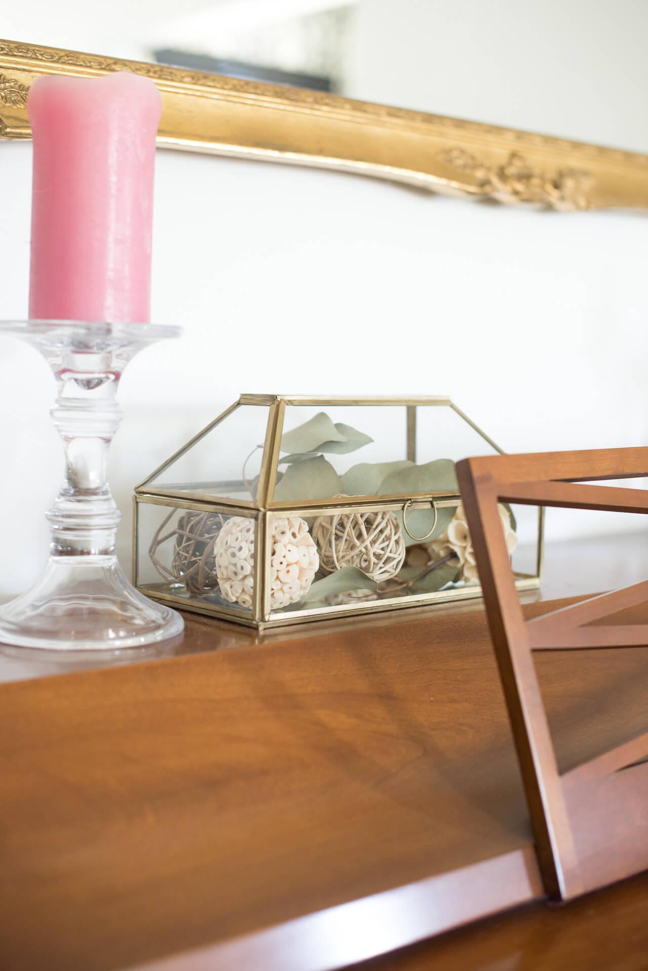 glass curio box on piano