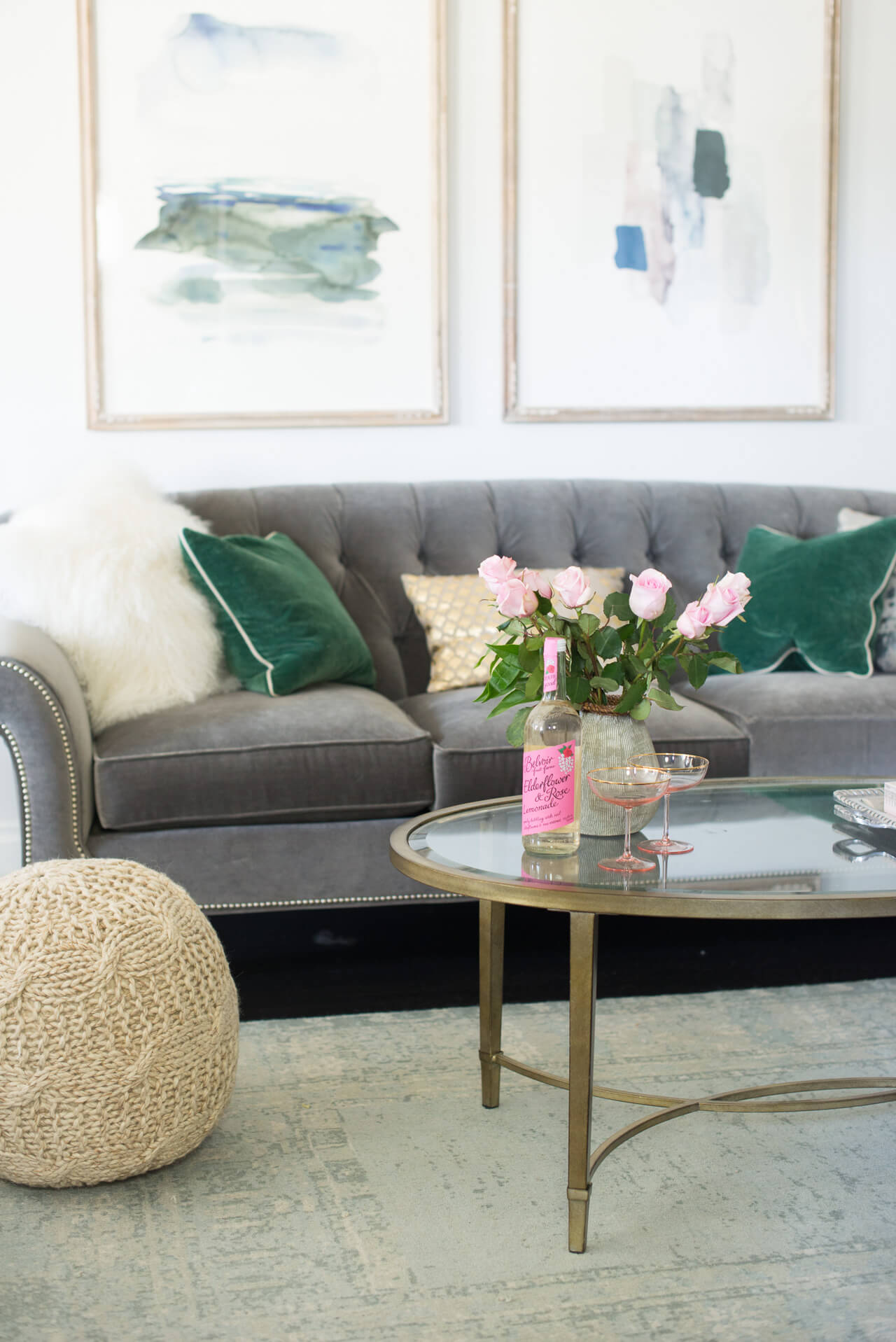 tips for styling a living room with a gray couch and brass coffee table