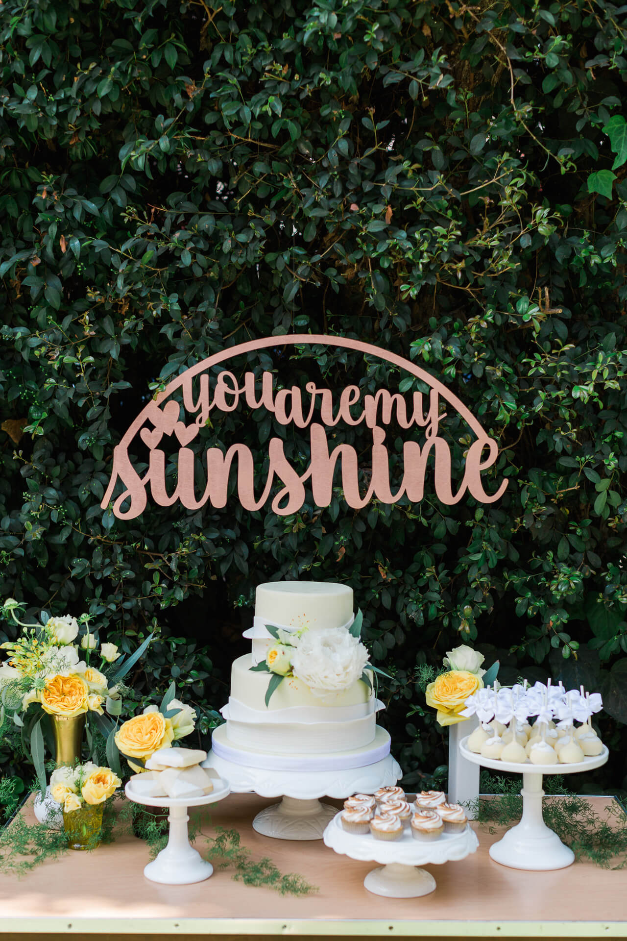 baby shower dessert table with you are my sunshine wooden sign