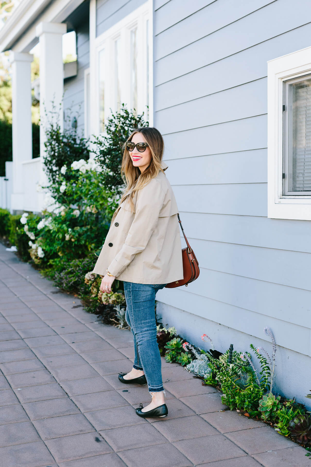 pair an everyone short trench coat with jeans for a modern twist on a timeless classic