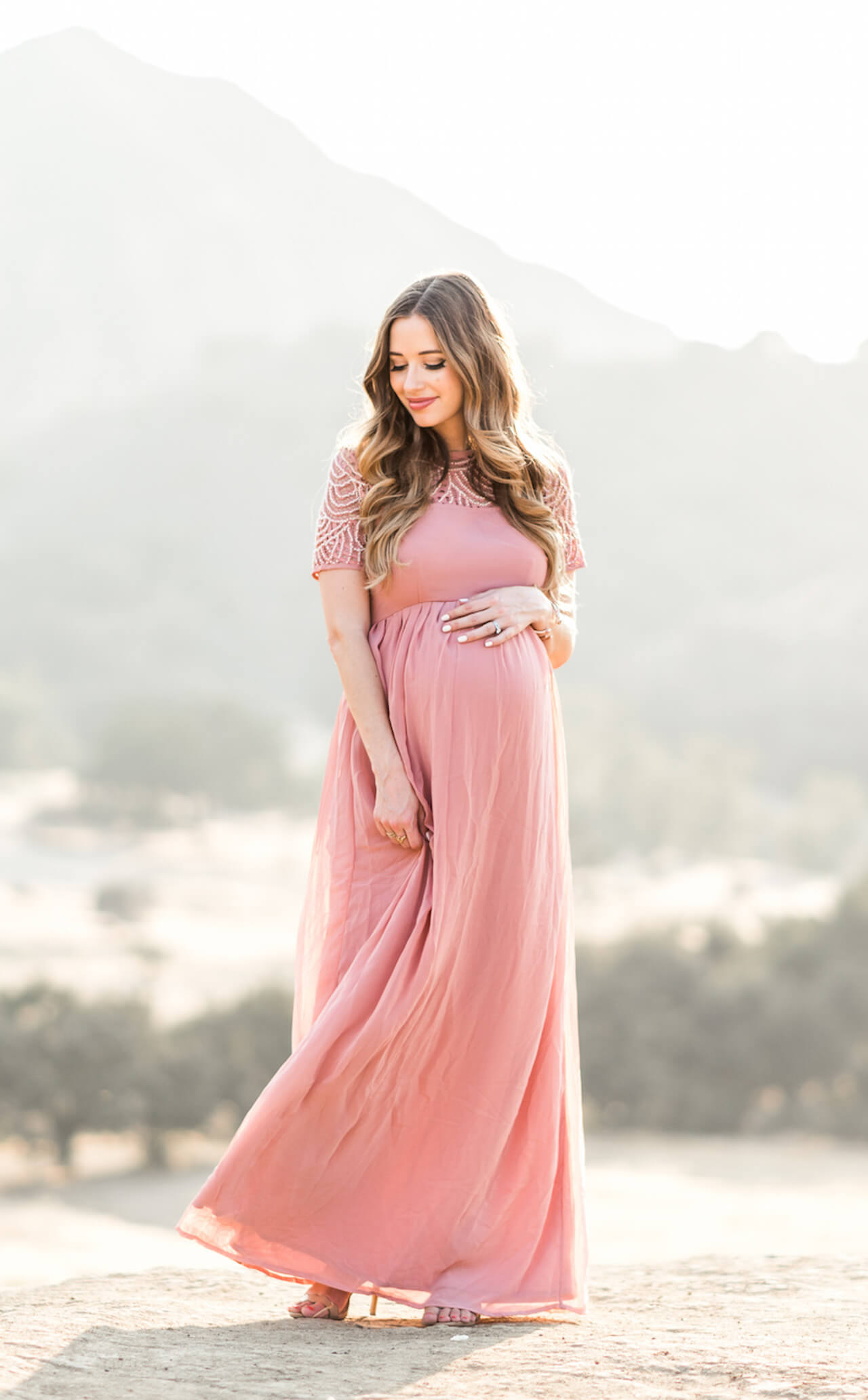 a flowy pink maternity maxi dress