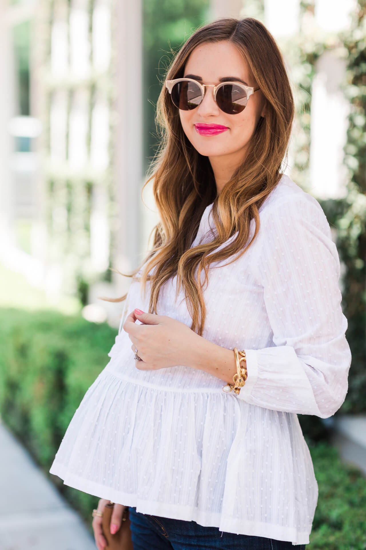 styling a white peplum top with retro sunglasses