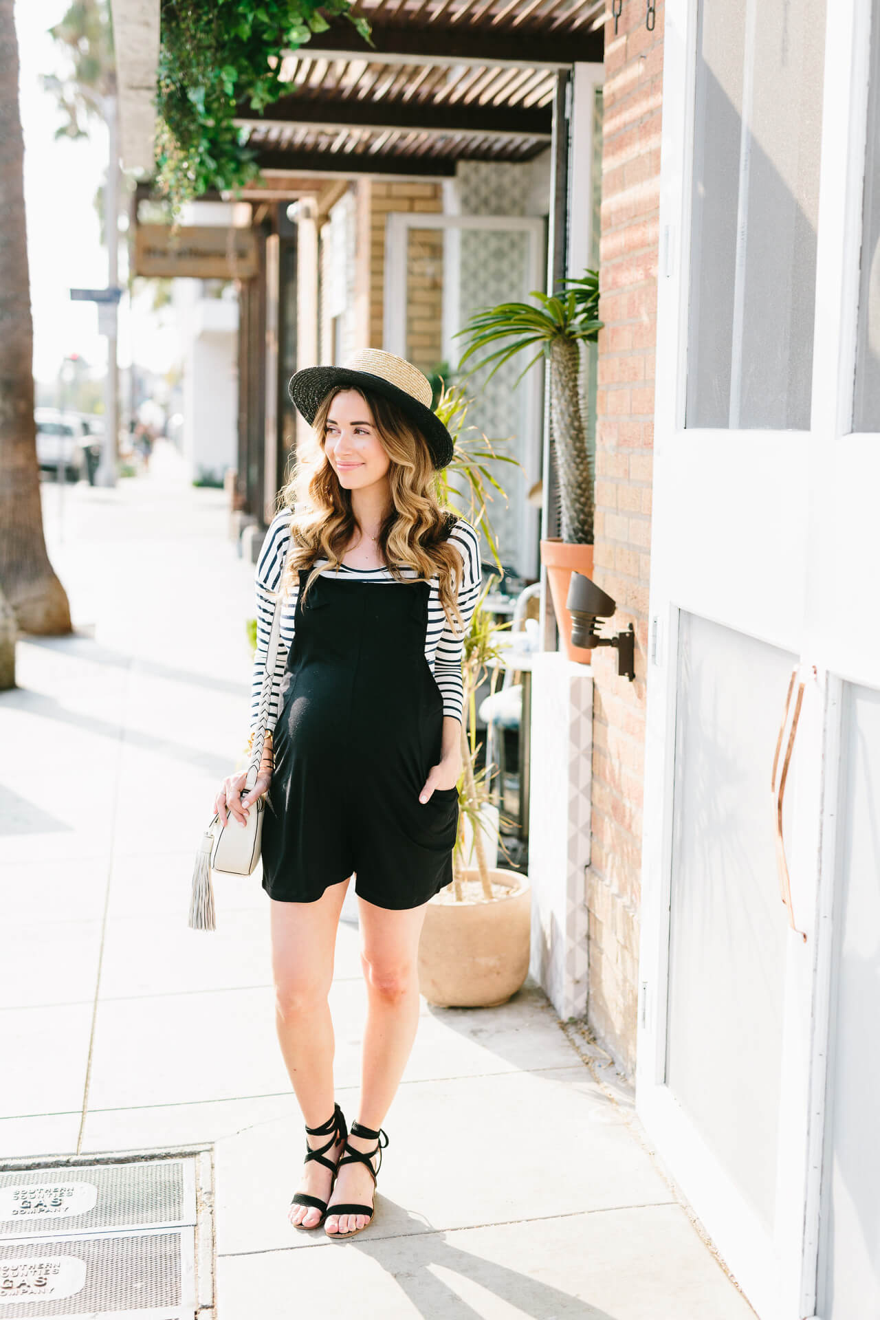 black overalls with striped shirt and boater hat