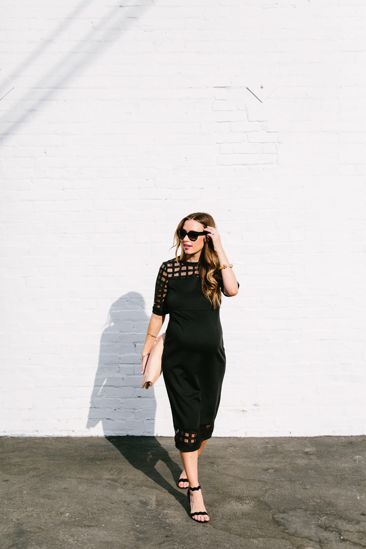 a classic black dress to wear when pregnant