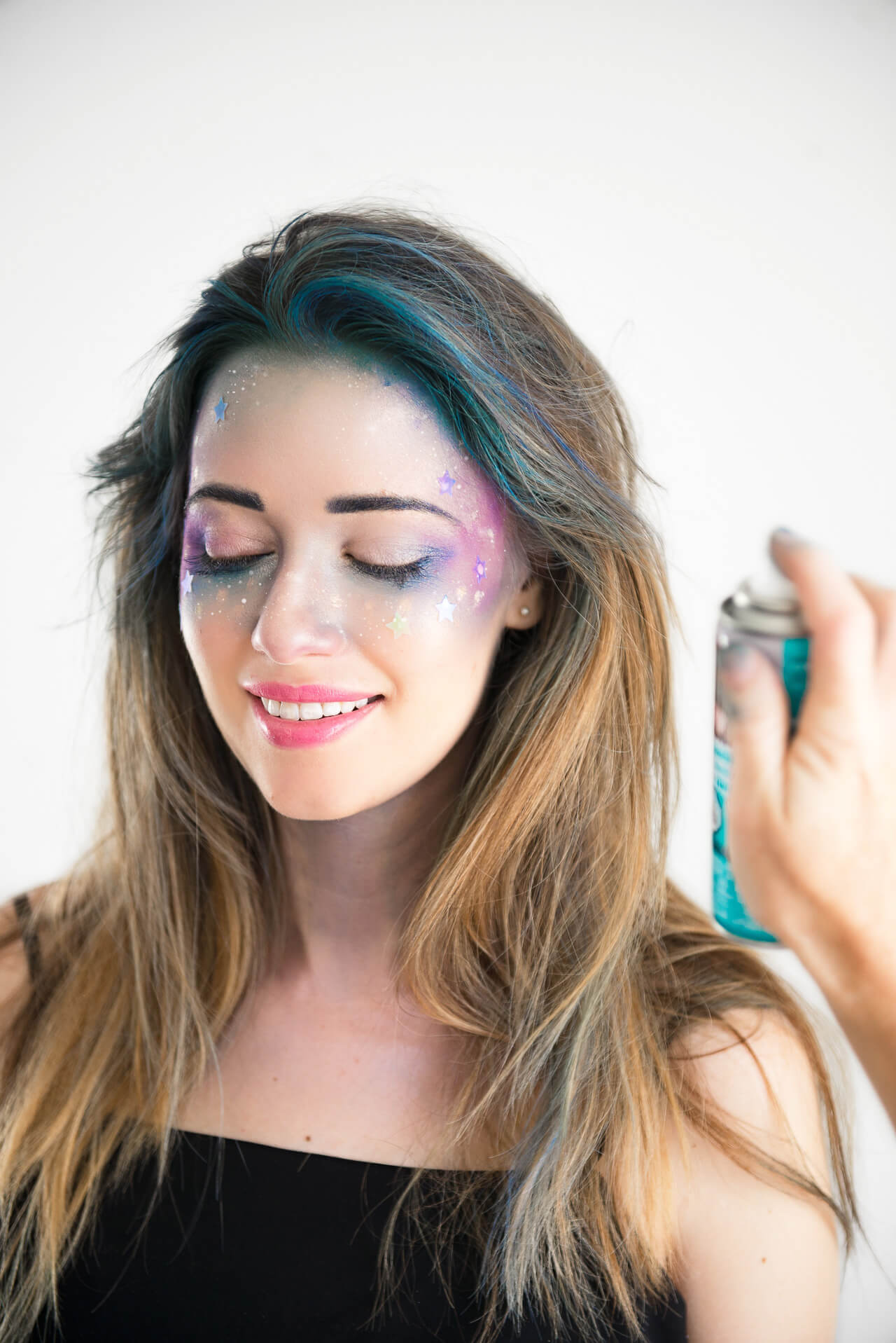 using colored hairspray for a halloween makeup tutorial