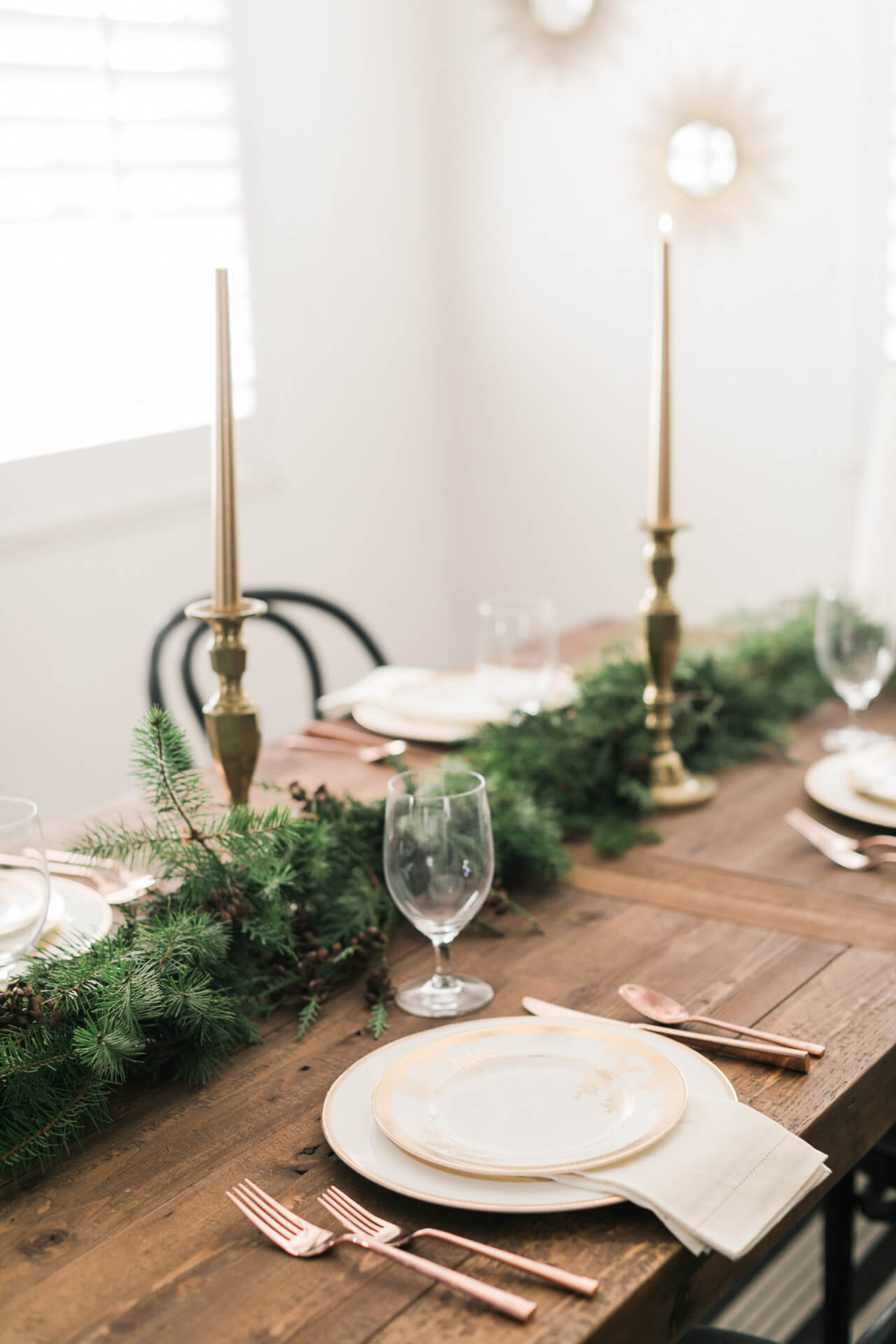 pine garland on the dining room table