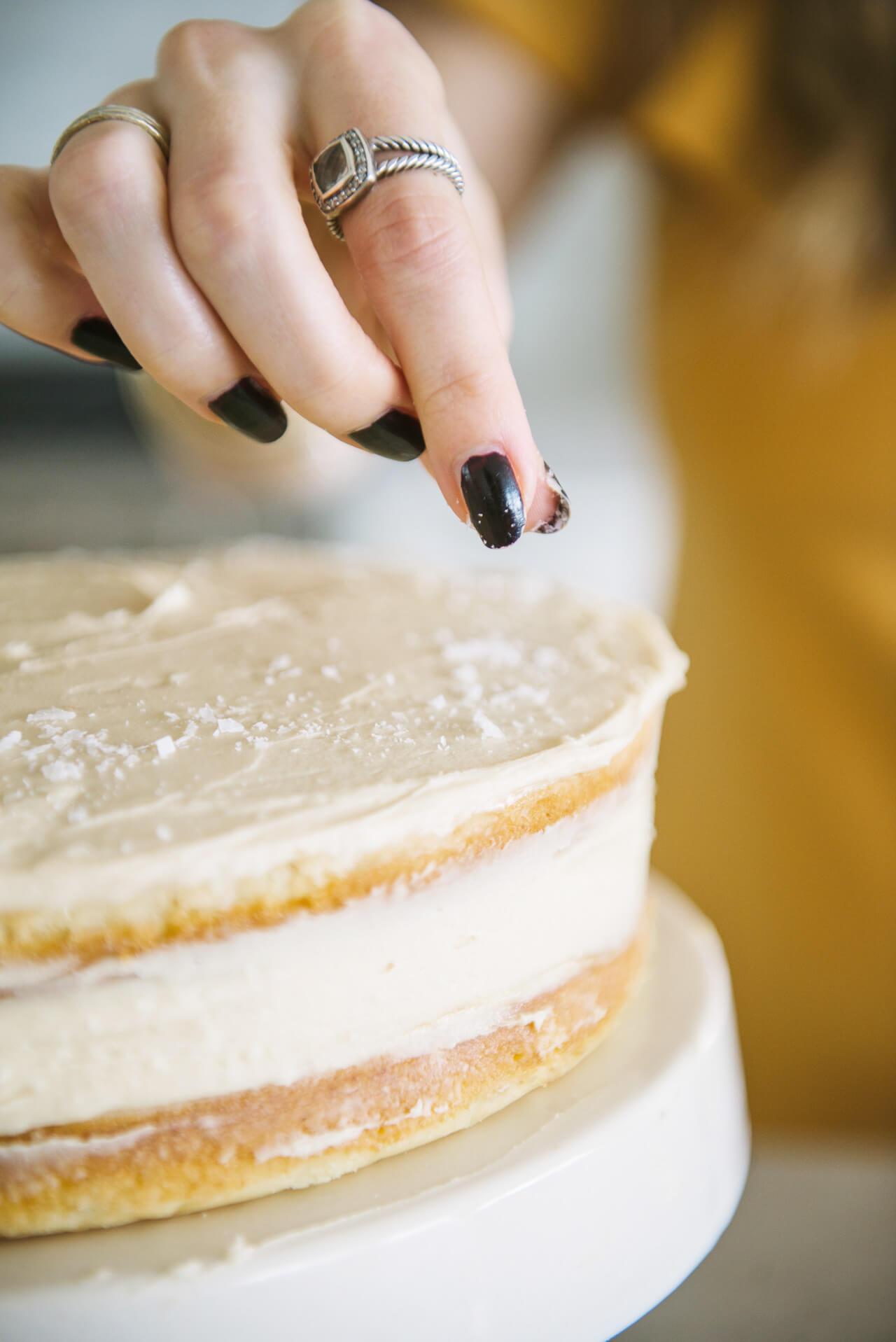 flaky sea salt on vanilla bean cake