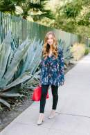 flowy top with black jeans and red bag