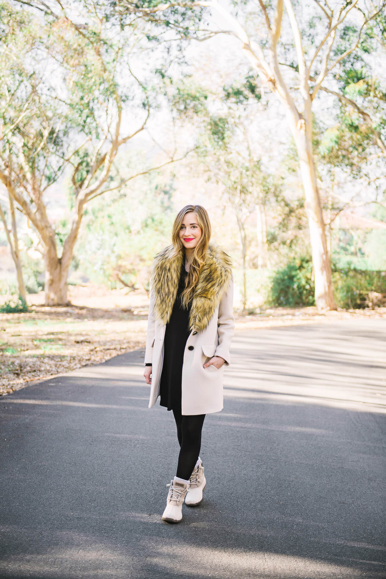 dressing up duck boots with a dress and coat during winter