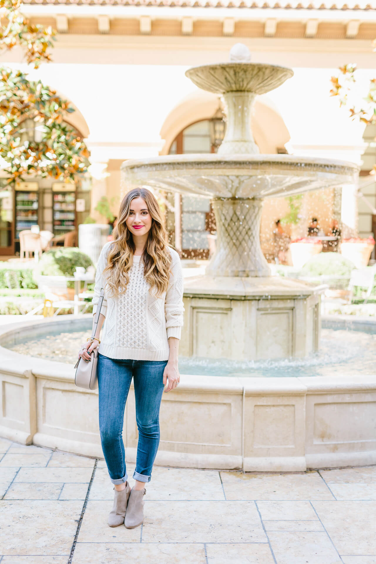 my go-to fall outfit- white knit sweater with jeans and ankle booties