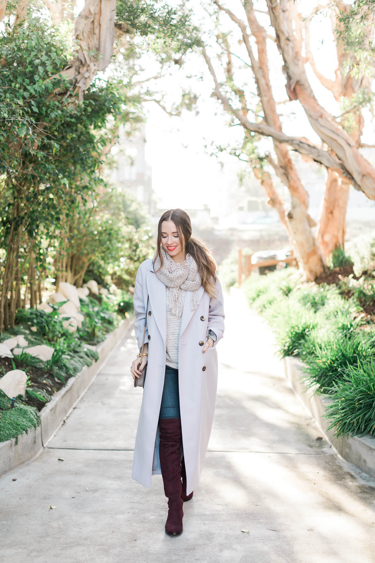 long lavender coat with burgundy over the knee boots