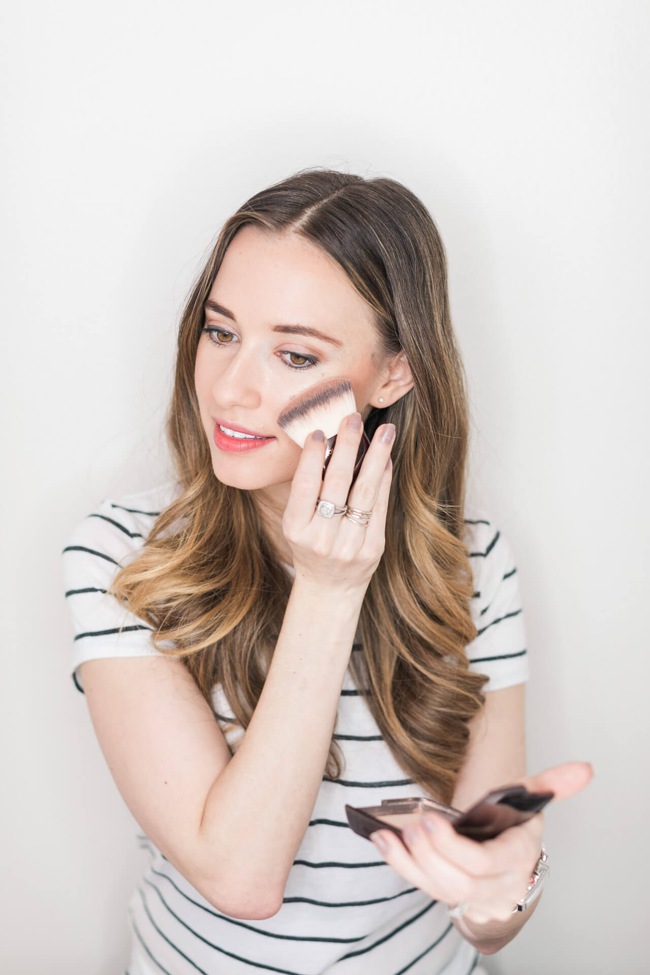 using a powder highlighter from hourglass