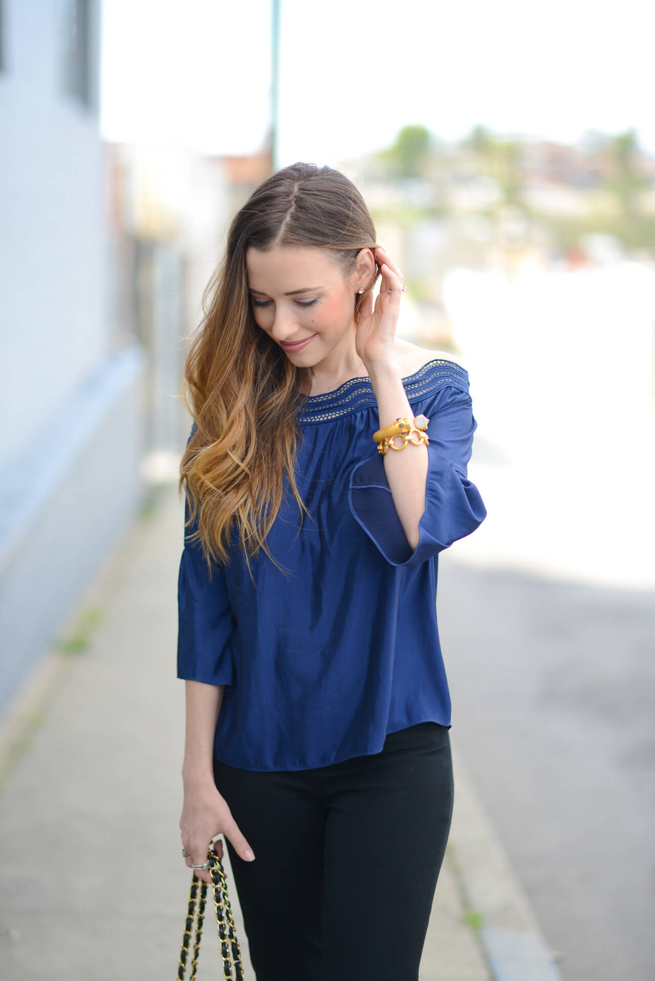 navy top with black pants