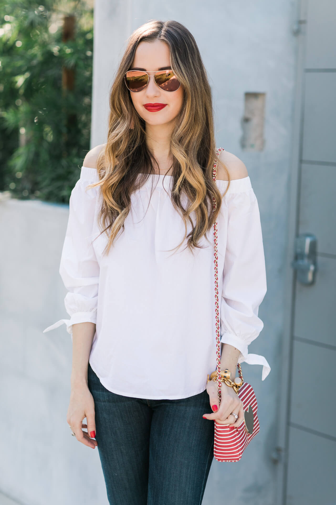 pink aviators with white off the shoulder top