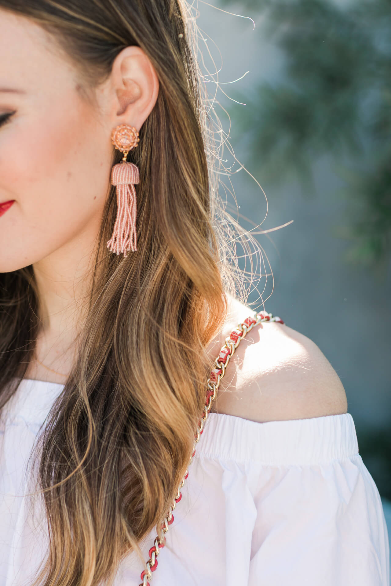 pink beaded tassel earrings look so cute with this off-the-shoulder top