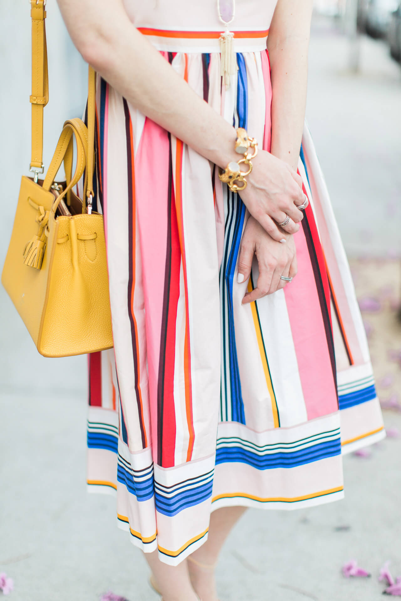 kate spade berber fit and flare dress with mustard yellow bag