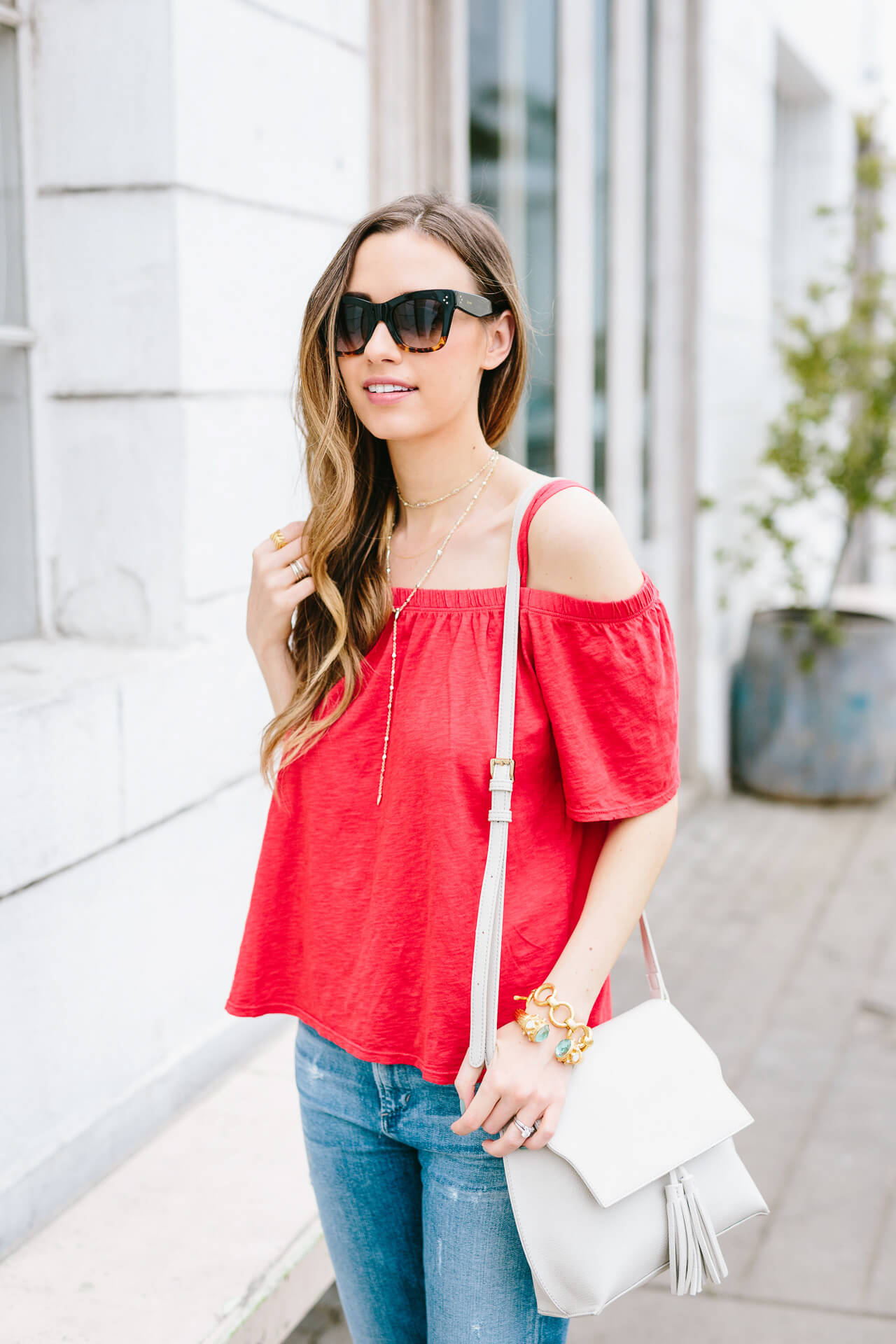 red off-the-shoulder cold shoulder top with sole society tassel bag