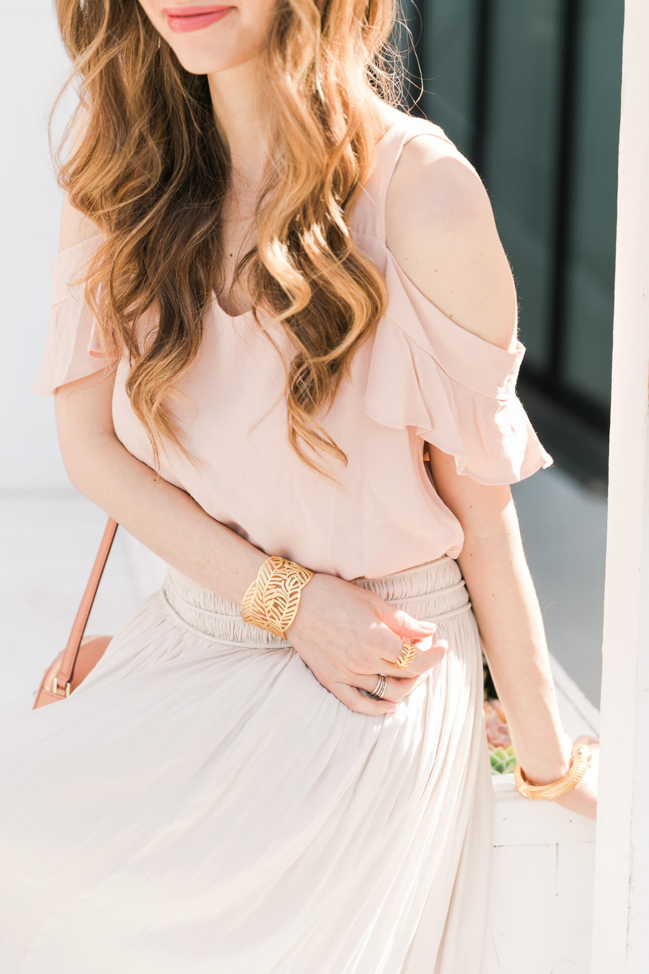 pink cold shoulder top with cream skirt