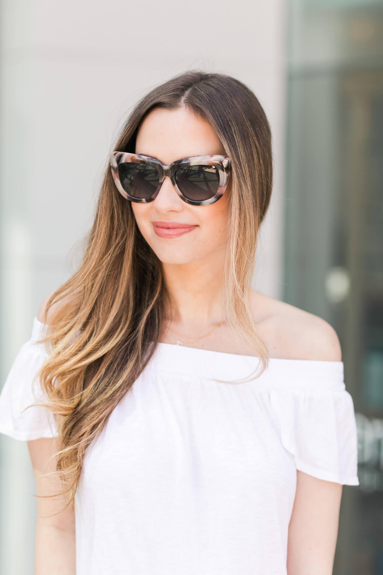 white off the shoulder top with pink tortoise sunglasses