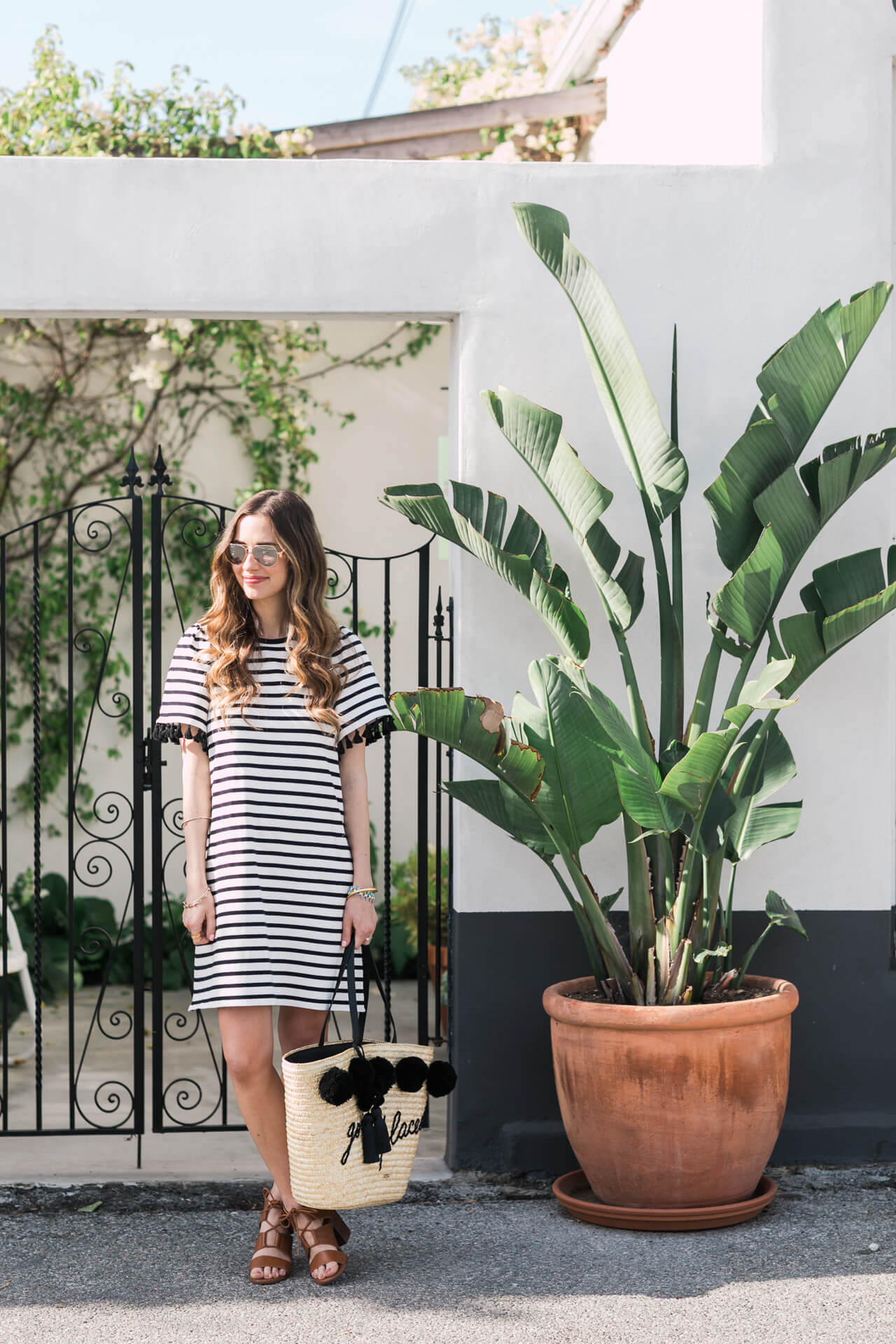 cute casual outfit inspiration for spring or summer - striped dress and brown sandal heels
